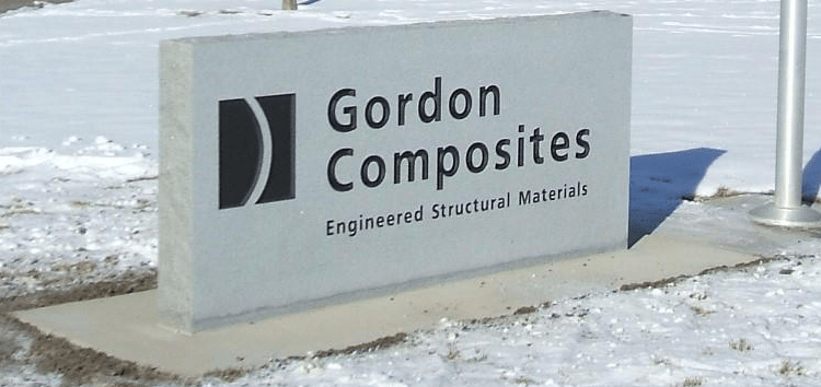 Custom engraved commercial stone signs for Gordon Composites